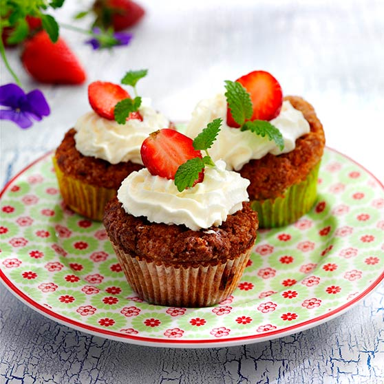 Strawberry muffins with whipped cream