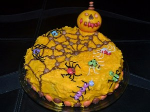 Smarties orange chocolate spider and creepy crawlies Halloween cake