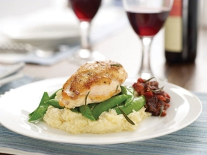 Pan-roasted chicken breasts with tomato compote and parsnip puree