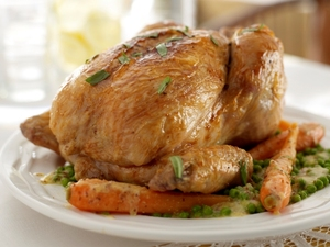 Mustard buttered chicken with tarragon, peas and carrots
