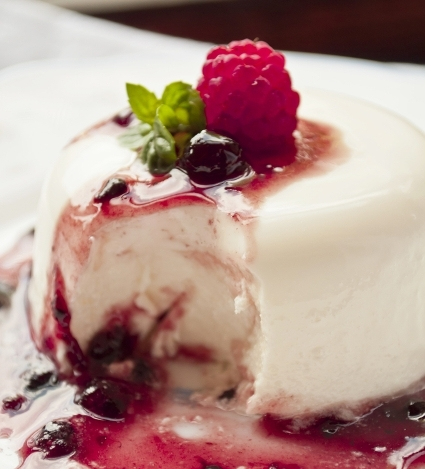 Vodka and buttermilk pana cotta with seasonal berry coulis