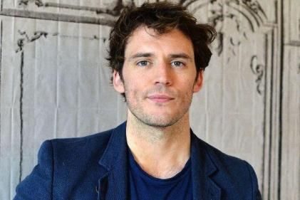 Embrace the challenge: Sam Claflin calls for more paternity leave for dads