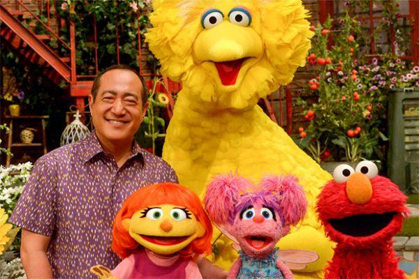 Sesame Street is giving kids a lesson in how to hug their friends with autism