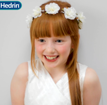 Gorgeous First Holy Communion hairstyle with flowers