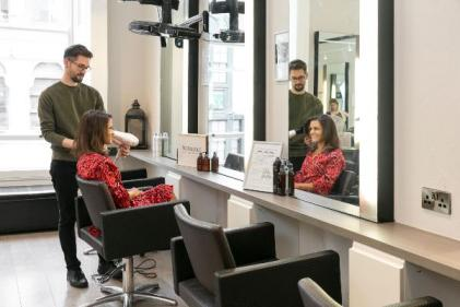 Hermans hair salon celebrates welcoming their 5 millionth customer