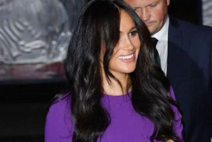 The Duchess of Sussex wore the most beautiful purple dress last night