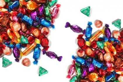 Show you care with a tin of personalised Quality Street