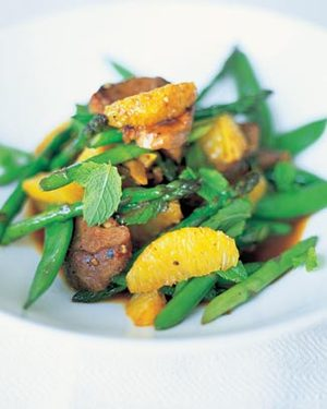 Stir fried duck with sugar snap peas and asparagus