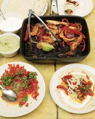 Chicken fajitas with homemade guacamole and salsa