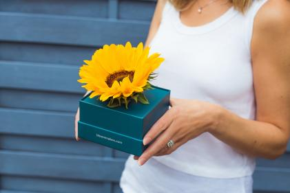 Hidden Hearing gifts sunflowers to brighten families lives