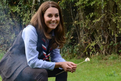 Kate wears her camping clothes to toast marshmallows over cosy bonfire