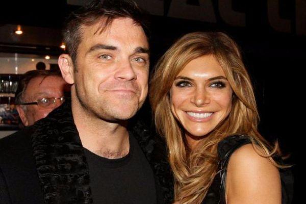 Robbie Williams 'tests positive' while on family holiday in the Caribbean