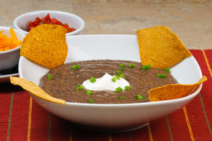 Black bean soup with hot roast pepper cream