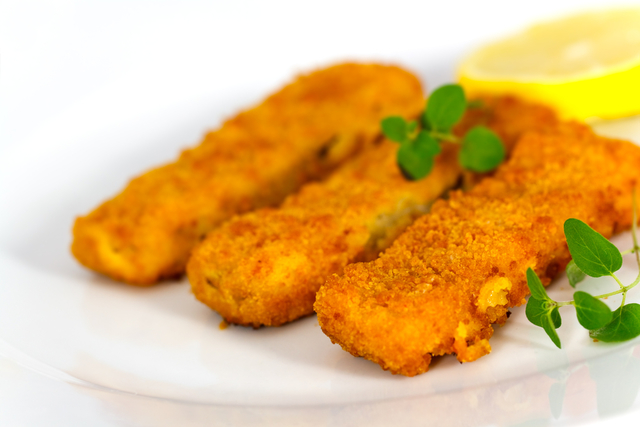 Homemade fish fingers with sweet potato cubes
