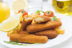 Salmon fish fingers with tomato and basil dip
