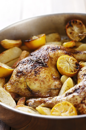 Lemon and herb roast chicken with new potatoes