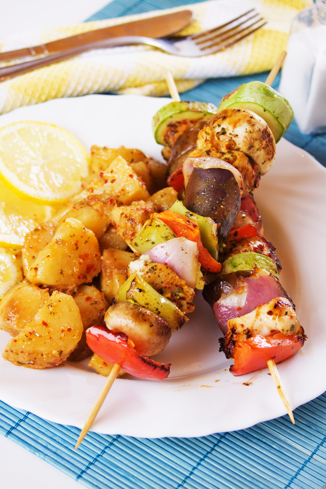 Pesto chicken kebabs with roasted vegetables