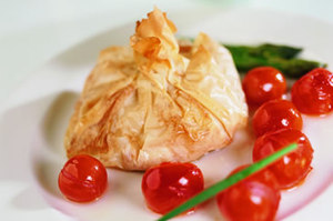 Salmon filo pastry parcels with cherry tomato compote