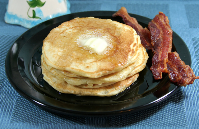 Banana pancakes with crispy bacon and syrup