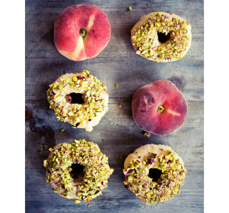 Peach doughnuts glazed with white chocolate and pistachios