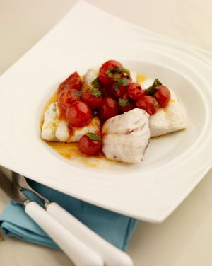 Hake with tomatoes and basil