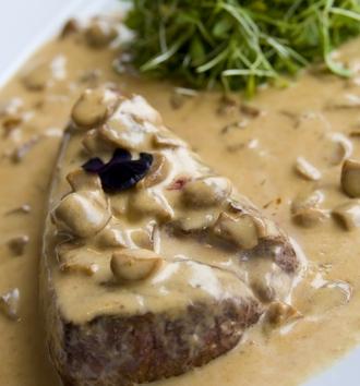 Prime steak with a creamy mushroom sauce