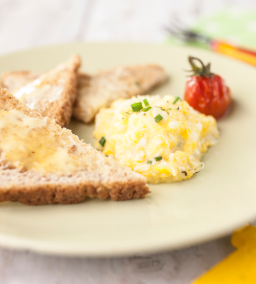 Scrambled eggs with cheese and tomatoes