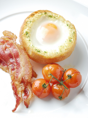 Garlic egg in a hole with bacon