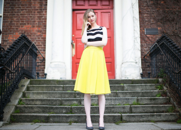 Striped top and yellow skirt
