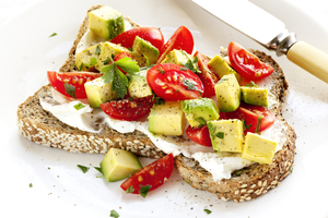 Avocado and tomato open sandwich