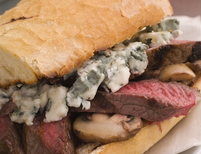 Toasted baguette minute steak with a mushroom and blue cheese sauce