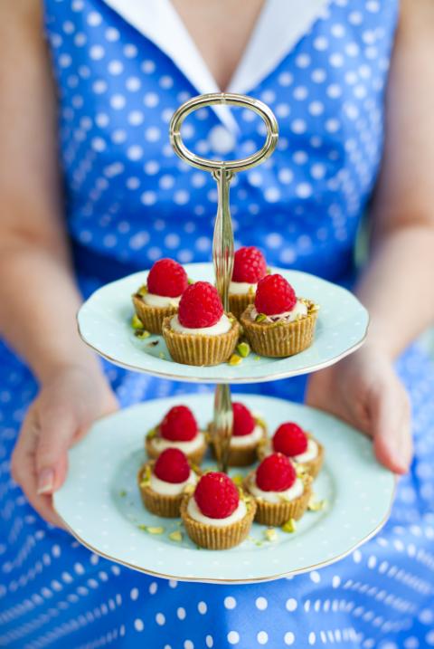 Teeny white chocolate, pistachio and raspberry tarts