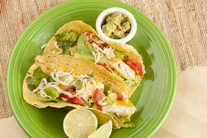 Fun fish tacos with slaw and fresh guacamole