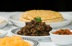 Black bean dip with fresh salsa and tortilla chips