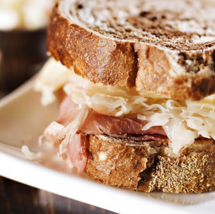 Homemade coleslaw and ham sandwich