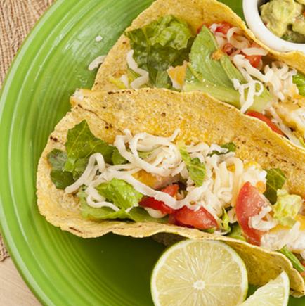 Fun fish tacos with slaw and fresh guacamole