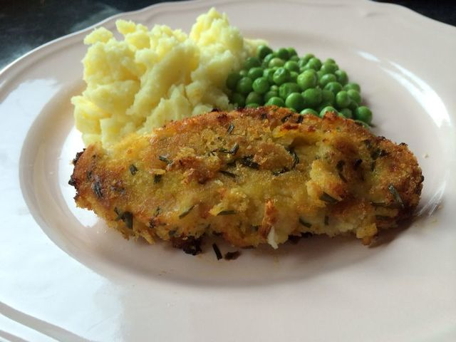 Homemade oven baked pork cutlets with mash and peas