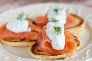 Smoked salmon with crème fraiche pancakes