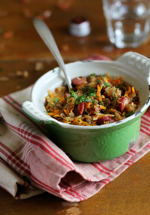 Spiced sausages stew with mixed beans and herbs