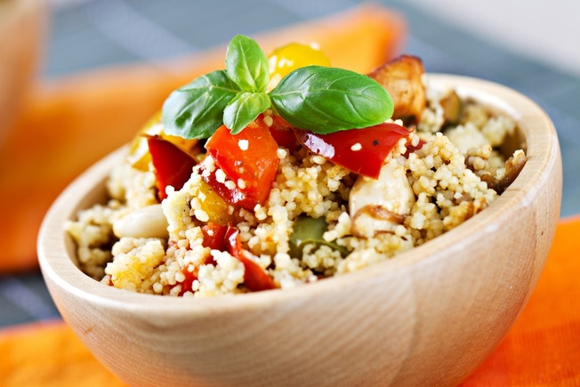 Roast tomatoes with couscous and harissa