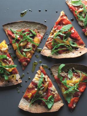 Tortilla pizza with tomatoes, pecorina cheese and rocket
