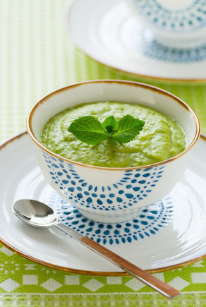 Pea soup infused with mint and spring onions, served with parmesan biscuits