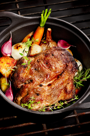 Pot roast pork with herbs and new carrots