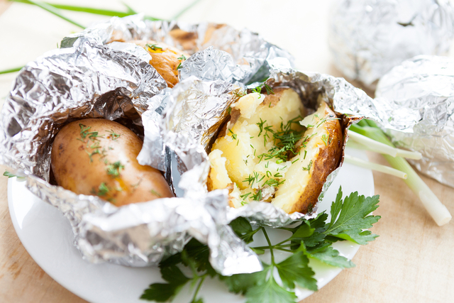 Spring onion jacket potatoes with smoked fish