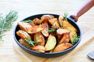 Crispy potato skins with chive dip