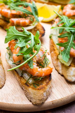 Prawn bruschetta with a fennel and lemon salad