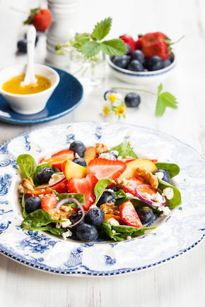 Goats cheese with fruit salad and walnuts