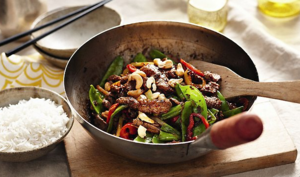 Stir-fried beef with snow peas, black beans and chilli