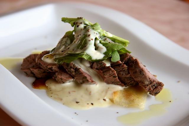 Rib-eye steak with herb hollandaise