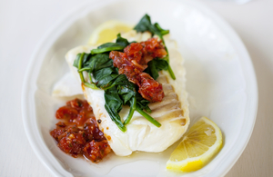 Baked cod with zesty salsa and spinach topping